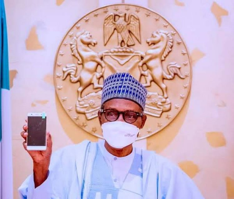 President Buhari Receives First Made-In-Nigeria Phone