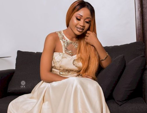 Akuapem Poloo takes down horrendous photo after being accused of child abuse.